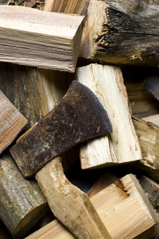 Axe Laying On Fire Wood Stock Image