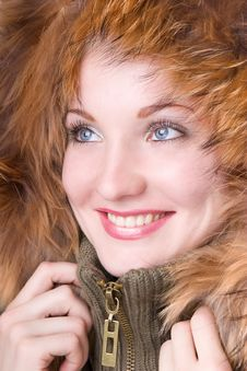 Young Woman In A Jacket With Fur Stock Photos
