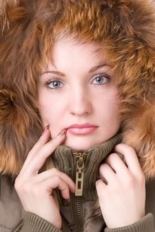 Young Woman In A Jacket With Fur Stock Images