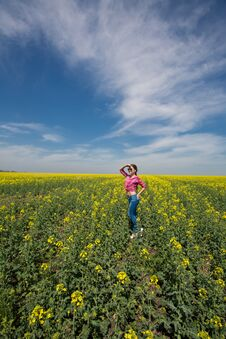 Young Beautiful Woman In Flowering Field In Summer. Outdoors Stock Photo