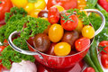 Free Assorted Cherry Tomatoes In A Colander, Garlic, Spices And Herbs Royalty Free Stock Images - 36026889