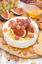 Free Camembert With Grapes, Figs, Honey, Crackers And Walnuts Royalty Free Stock Images - 36027099