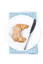 Free Croissant And A Knife On A Plate Isolated Stock Photography - 36027192