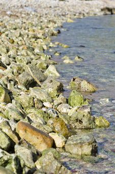 Free Stones & Pebbles Forming A Shoreline Stock Photos - 36026053