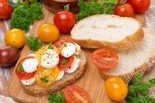 Ciabatta With Mozzarella And Colorful Cherry Tomatoes Royalty Free Stock Photos