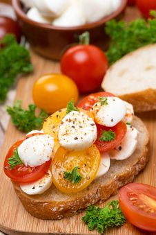Ciabatta With Mozzarella And Colorful Cherry Tomatoes, Close-up Royalty Free Stock Image