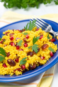 Free Couscous With Curry, Dried Cranberries And Herbs On The Plate Stock Images - 36027154