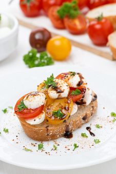 Piece Of Ciabatta With Mozzarella And Colorful Cherry Tomatoes Stock Photography