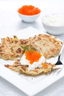 Potato Pancakes With Red Caviar And Sour Cream, Vertical Stock Photo