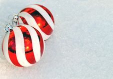 Christmas Tree Ornaments On Snow Stock Photos