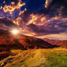 Free Autumn Hillside With Red And Yellow Forest At Sunset Stock Images - 36030044