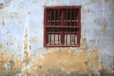 Window With Bars And Newspapers In An Old Grungy Wall, Daxu, China