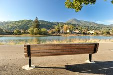 Free Wooden Bench By A River With Mountains Stock Image - 36050131
