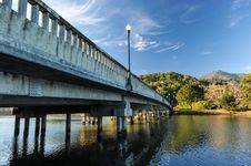 Free Concrete Bridge With Light Pole Over River Stock Photos - 36050843
