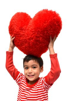 Free Little Boy Hold Pillow Red Heart Stock Photo - 36058250
