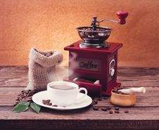 Free Cup Of Warm Coffee And Grinder. Stock Images - 36059434