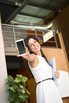 Free Casual Businesswoman Showing Cellphone Stock Photo - 36064960