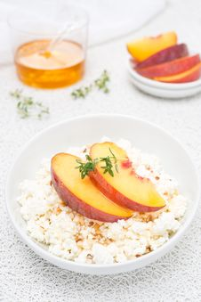 Fresh Homemade Cottage Cheese With Honey, Walnuts And Peaches Royalty Free Stock Images