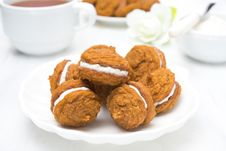 Free Pumpkin Cookies With Cream Filling And Tea Royalty Free Stock Images - 36070659