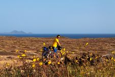 Free Woman With Bike On Canary Island Stock Photos - 36070963