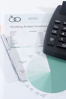 Free Wedding Budget With Calculator And Pen Stock Photo - 36078440