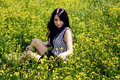 Free Happy Woman Sitting On Yellow Sunny Flowers Field Stock Image - 36083751
