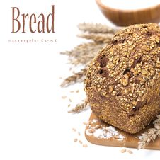 Whole Grain Bread With Seeds And A Bowl Of Flour, Isolated Stock Photography