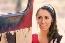 Free Woman Beside Old Rusty Truck Door Royalty Free Stock Images - 3610309