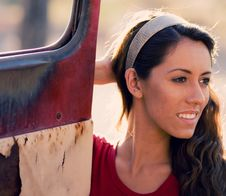 Woman Beside Old Rusty Truck Door