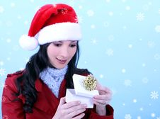 Free Young Woman Opening A Christma Stock Images - 3618264
