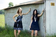 Free Two Young Women In Dresses Standing Next To The Garage Royalty Free Stock Photography - 36114577