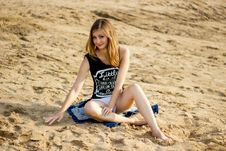 Free Lonely Smiling Girl Relaxing On The Sunny Sea Sand Beach Stock Photography - 36114712