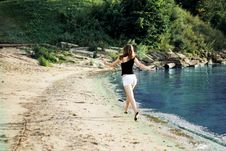 Happy Woman Running Jumping Trough The Beach Royalty Free Stock Photo