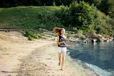 Happy Woman Running Jumping Trough The Beach Stock Image