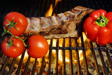Free Ribs Roasted In A Barbecue With Pepper And Tomatoes Royalty Free Stock Photo - 36115485