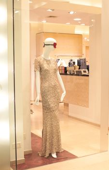 Evening Dress In Shopping Window Royalty Free Stock Photography