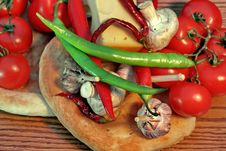 Fresh Bread And Vegetables On A Wooden Panel Stock Photo