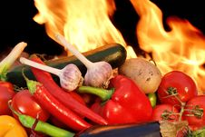 Assorted Fresh Vegetables And Flames Stock Image