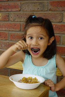 Free Young Asian Girl Eating Breakfast Cereal. Stock Photos - 36150603