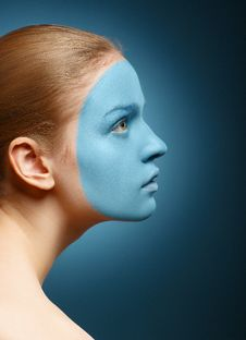 Young Girl With Facial Mask. Royalty Free Stock Images