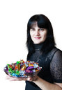 Free Young Beautiful Woman In Black Blouse Holding A Dish Of Candy Stock Images - 36161274
