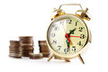 Free Alarm Clock And Coins In Pile Stock Images - 36166964