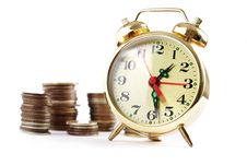 Alarm Clock And Coins In Pile Stock Images