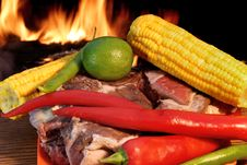 Free Fresh Rib Steak And Vegetables At The Flames Of Coal BBQ Facilit Royalty Free Stock Images - 36169569