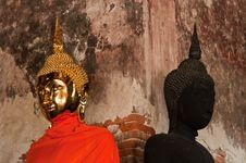 Golden Buddha Stute And Black Stute In Ancient Temple Of Thailand Royalty Free Stock Photo