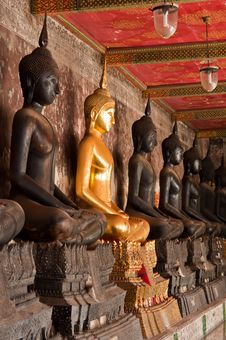 The Sitting Golden Buddha Stute And Black Stute In Ancient Temple Of Thailand Royalty Free Stock Photos