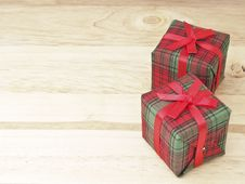 Pair Gift On Wood Stock Images