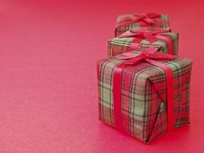 Triple Gift On Red Royalty Free Stock Photos