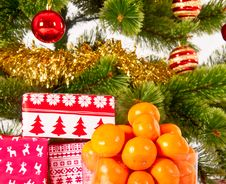 Christmas Tree With Gifts And Mandarines Stock Photography