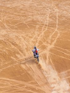Racer On A Motorcycle Ride Through The Desert Stock Photo